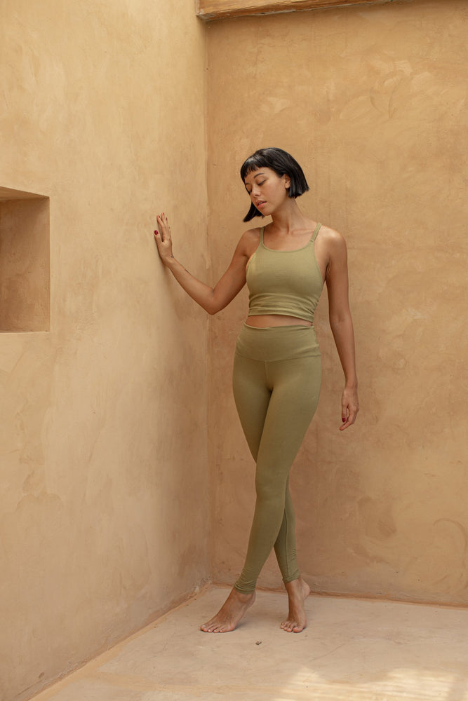 Woman standing, wearing Ananda Legging colour Olive