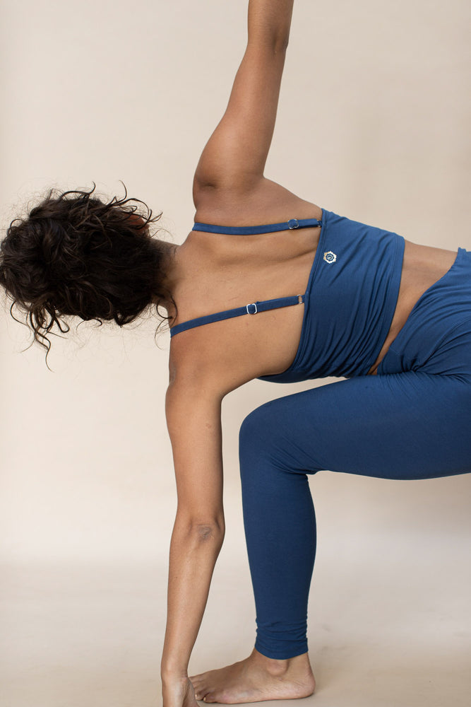 Woman practising yoga, wearing Ananda Tank colour French Blue