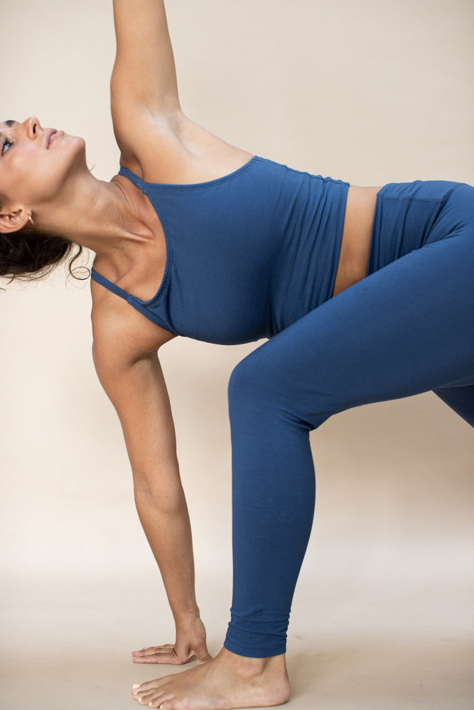 Load image into Gallery viewer, Woman practising yoga, wearing Ananda Tank colour French Blue