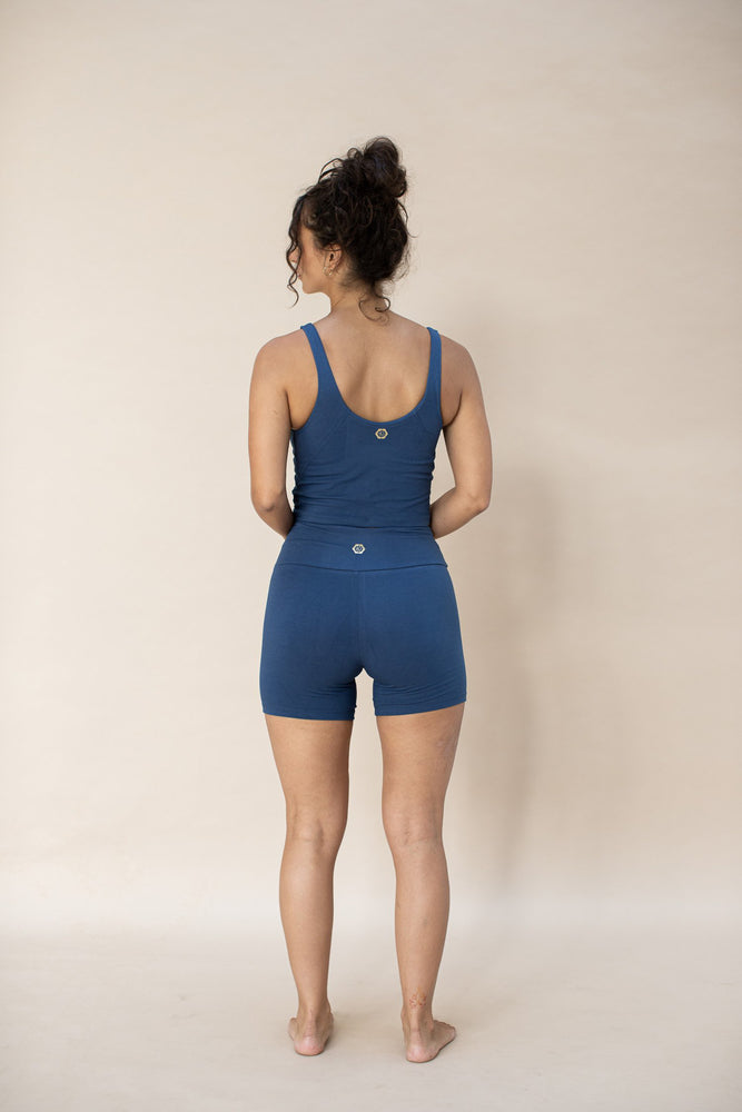 Woman wearing Ananda Yoga Shorts colour French Blue