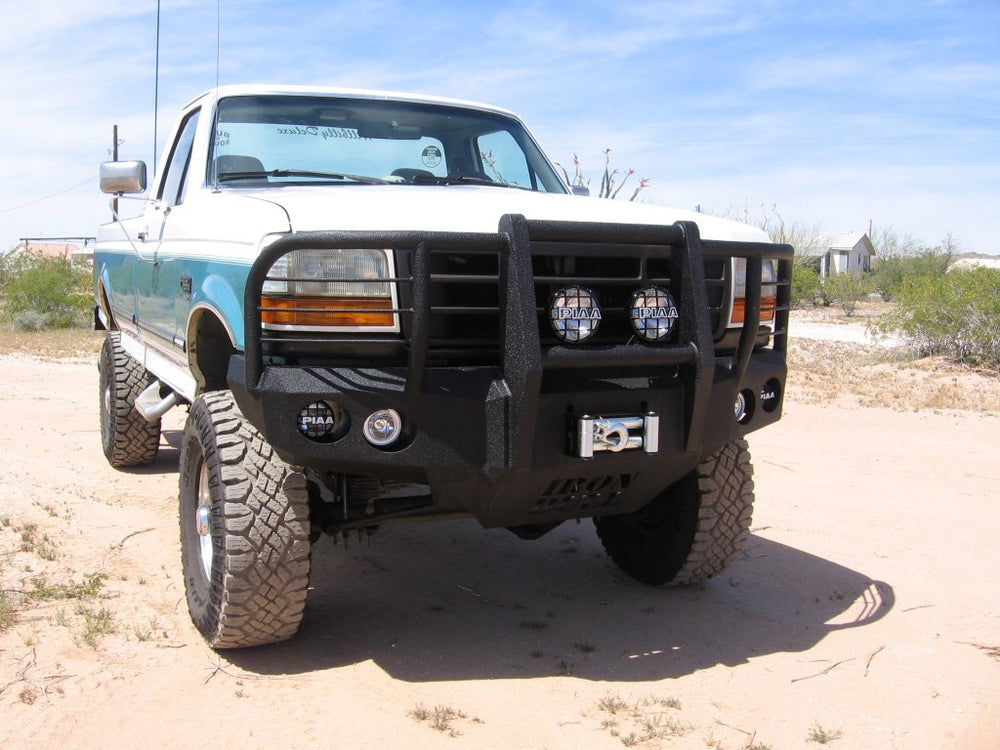 1992-1996 Ford F-250/350 Front Base Bumper - Iron Bull Bumpers - FRONT IRON BUMPER - Metal bumper for heavy duty trucks Perfect for CITY/OFF-ROAD applications with Light Buckets and Winch Mount included