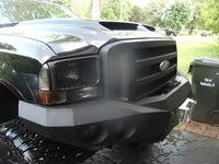 1999-2004 Ford F-250/350 Front Base Bumper - Iron Bull Bumpers - FRONT IRON BUMPER - Metal bumper for heavy duty trucks Perfect for CITY/OFF-ROAD applications with Light Buckets and Winch Mount included