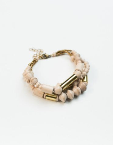 Brass and paper bracelet handmade in Bali and Uganda