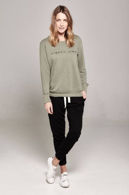 organic cotton black track pants and green jumper