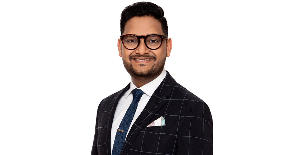 Professional business headshot with glasses