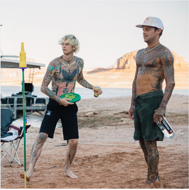 Machine Gun Kelly and Ryan Sheckler playing Bottle Bash outdoor game.