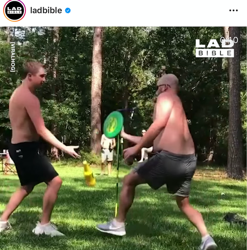 Lad Bible two playing outdoor lawn game Bottle Bash