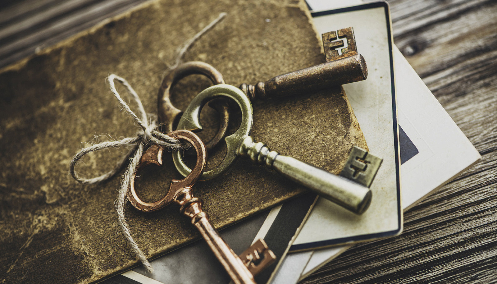Image of three keys with twine and mysterious papers. Can you solve the puzzle of these papers?