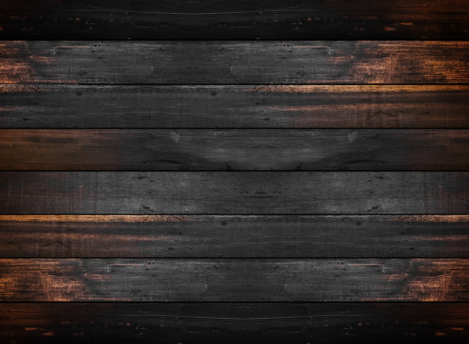 Background image of rustic, raw wood panels of exterior of escape room.