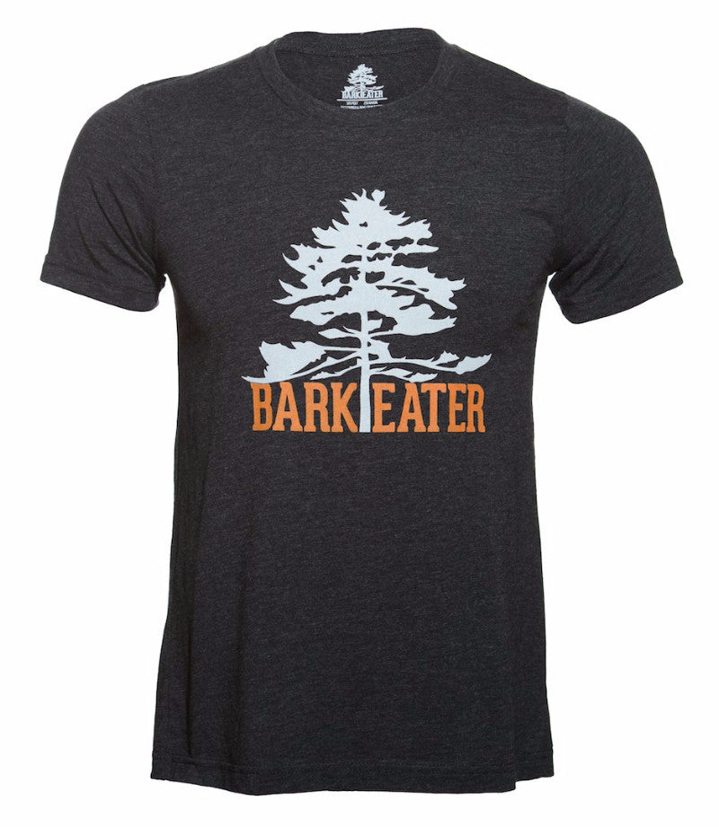 Centered on the chest of a charcoal grey triblend tee shirt is Bark Eater Outfitters logo. An eastern white pine in light grey with Bark Eater at the base of the tree in burnt orange. The trunk of the tree seperates Bark and Eater
