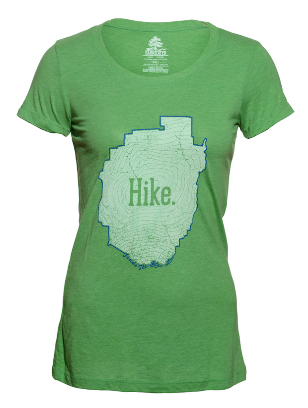 An incredibly soft unisex Green triblend tee shirt with the outline of the Adirondack Park in blue ink. Inside the blue line is a topographic map of Mt Marcy, New York's highest peak, with the word Hike centered on the front of the tee.