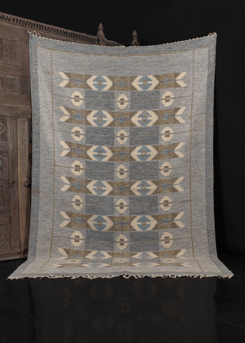 Swedish mid century kilim designed by Ingegerd Silow. Design is simple geometric, in palette of blues, greys, and white. Braided fringe ends, in perfect condition.