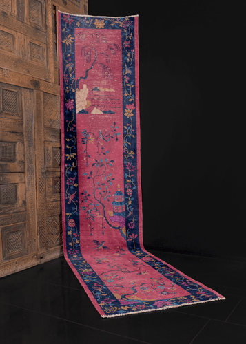chinese deco runner with a purple field and tree design in the centre, floral meander for the border. in good condition, signs of wear consistent with age.