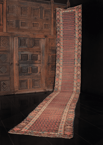 Early 20th century Kurdish runner with allover boteh or paisley design with geometric border. In excellent condition, edges have been reinforced for longevity.