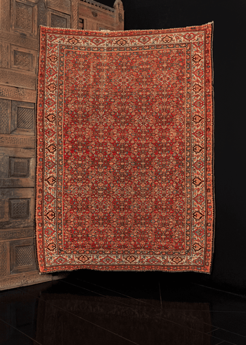 Malayer rug with allover herati pattern variation on a red field. in excellent condition, signs of wear consistent with age.