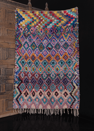 Vintage Moroccan Boucherouite rug with multicolor diamond design. braided fringe on one end. in excellent condition