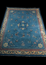 Antique Chinese Peking rug with sky blue field and pale pink and yellow border