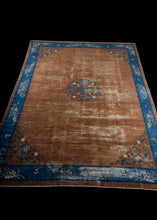 Antique Large Chinese  Peking Rug with  a brown field and blue border and accents