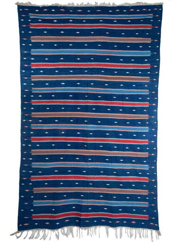 Antique Rajistani Jail Dhurrie handwoven cotton in repetitive pattern of blue, tan and red stripes on indigo blue field