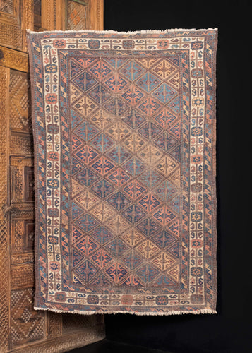 Antique NW Afghani Baluch rug with all over pastel diamond pattern.