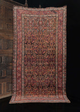 Antique NW Persian Kurdish finely woven wool rug featuring glistening tones of pink, brown, and burgundy