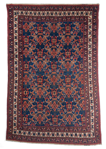 18th century Persian Afshar area rug with gorgeous blue and orange wool, floral design and three floral borders