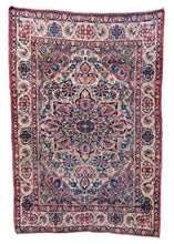 Antique Central Persian Lavar Kerman Area rug featuring a central medallion and many flowers