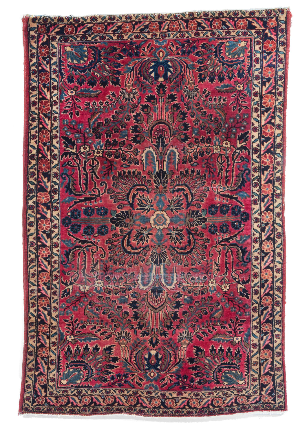 West Persian handwoven wool Sarouk rug with central medallion and pink field characteristic of Sarouk and Lillian rugs