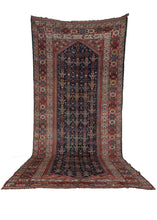 Antique South  Persian Khamseh rug featuring a rainbow of brilliant color