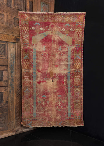 Mid 19th century handwoven Turkish Mejid Ghiordes rug.