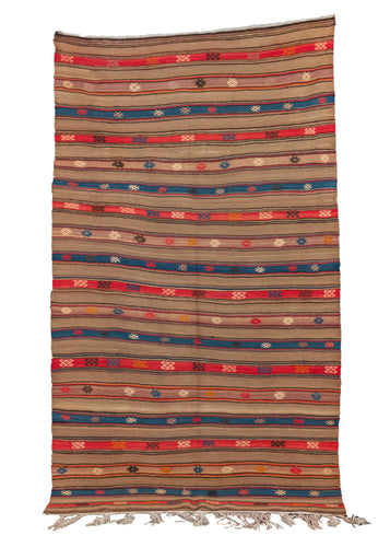 Vintage Turkish kilim, featuring a striped design with a taupe base and bright blues and reds as accent colors. The striped design is complemented by symbols and shapes throughout. In very good condition, signs of wear consistent with age.