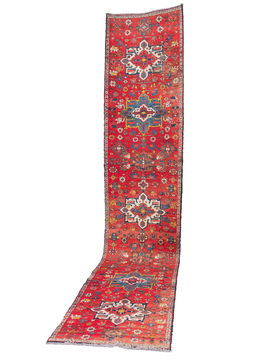 Mid-century Karaja rug with medallion design on a bright red field. Accent colors are blues, ivories, and browns. In good condition, with some moth damage throughout but foundation is still intact.