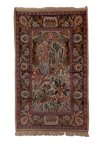 Small pictorial rug handwoven in India, featuring a variety of animals in a forest setting, and a rider on horseback. In excellent condition, signs of wear consistent with age.