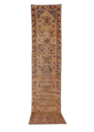 Vintage Khotan rug handwoven in NW China. Color palette is composed of an ivory ground, with details woven in blues, pinks, and browns. In fair condition, with some wear throughout.