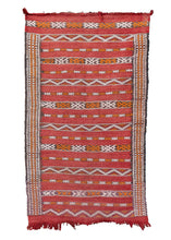 Vintage Moroccan kilim with a striped geometric design in black, white and, orange on a red ground. In fair condition, with some signs of wear but structurally sound.