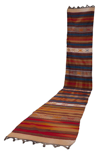 Vintage Turkish runner, with an earthy color palette and horizontal stripe design. In fair condition, with some color run throughout where the dyes have bled.