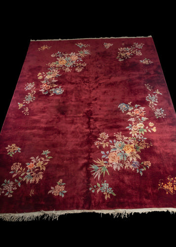 Burgundy Chinese Deco rug with multi colored flowers in balanced groupings