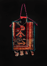 Vintage Armenian salt bag. Pile front with a flat woven back. Decorative tassels hang at bottom.