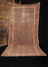 Northwest Persian rug handwoven first quarter of 20th century. Allover pattern of small both in blues and pinks. Main border classic design of leaves and flowers often found in the region.