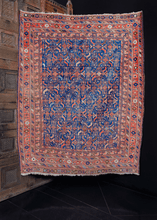 Afshar rug handwoven in Southeast Iran during the first quarter of the 20th century. All-over abstracted herati design of flowers and leaves on an electric blue field. Main border features daintily woven flowers.
