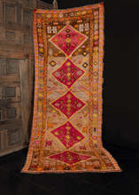 Kars runner from Eastern Anatolia handwoven during third quarter of 20th century. Five raspberry central medallions on a camel ground. Bright oranges and yellows provide contrasting details.
