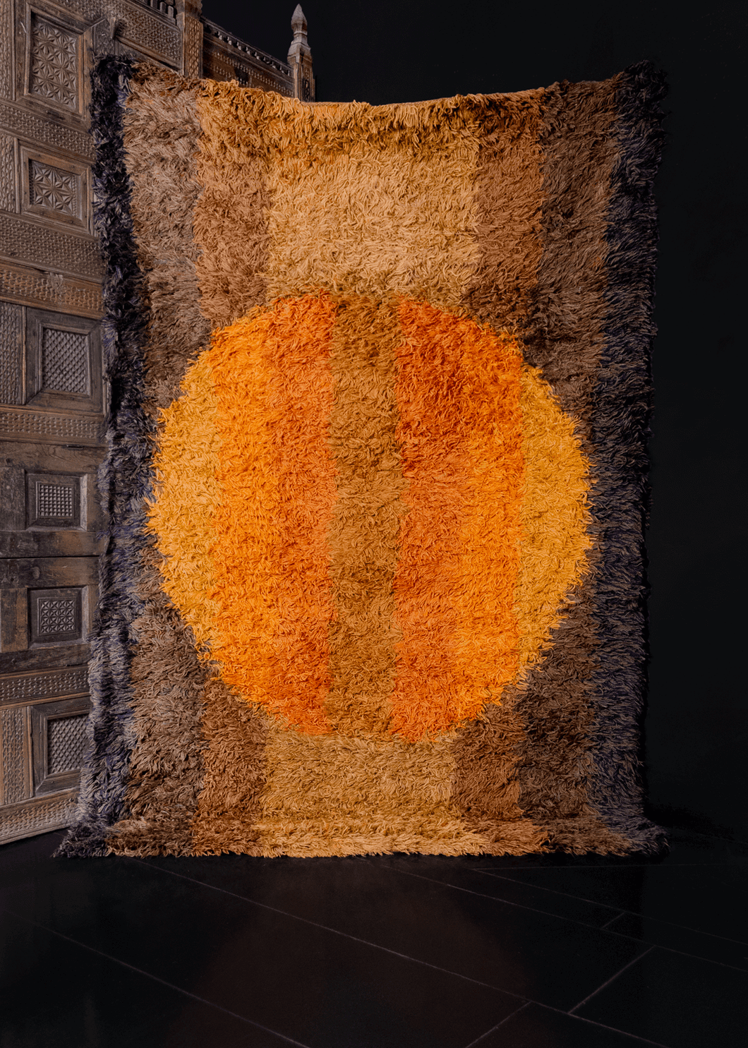 Vintage Rya rug handwoven in Sweden during third quarter of 20th century. Minimalist circle design in earth tones of gold, burnt orange and brown.