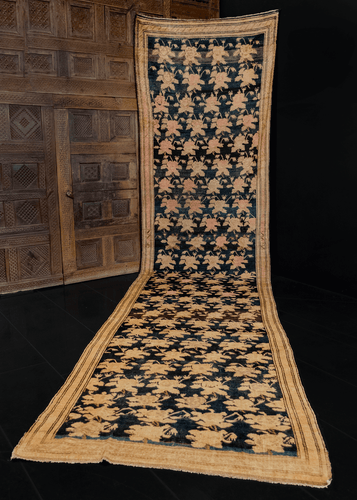 Armenian runner likely woven in Northwest Iran during second quarter of 20th century. Repeating pattern of soft pink and khaki roses on inky black field.