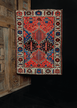 Bakhtiari Rug handwoven in Southern Iran during second quarter of 20th century. Garden design with interlocking polygons. Bold blues and reds paired with soft ivories and browns.