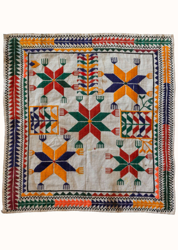 Vintage Hand Embroidered Afghani Pakistani Hazara Prayer Cloth with bright orange green and red colored stars and hands
