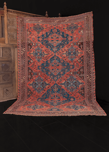 early 20th century caucasian soumak rug with lesghi star design in blue on pink field in great condition