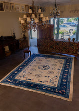 Fa-ti rug handwoven during first quarter of 20th century in China. Simple central medallion depicting plant filled vases. Pictoral scenes of birds and flowers lightly drawn in blue on tan ground.