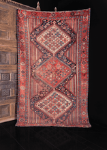 multicolor khamseh rug from early 20th century. three central medallions on a multicolor vertical stripe field