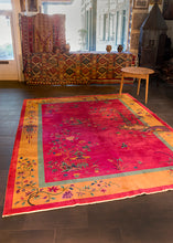 Deco rug handwoven during the 1930s in Tietsin, China. Features a stunning bright pink ground with a wide bright yellow border. Pictoral scene of lotus flowers surrounding two pagodas.