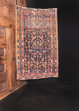 Bidjar rug handwoven second quarter of the 20th century in Northwest Iran. Deep blue, Surma, field with shades of pink, yellow, and white.